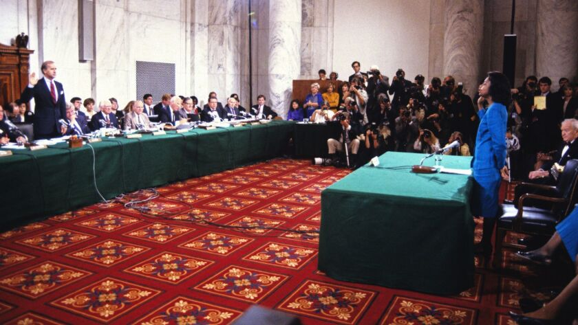 Professor Anita F. Hill, right, is sworn-in to testify before the United States Senate Judiciary Com