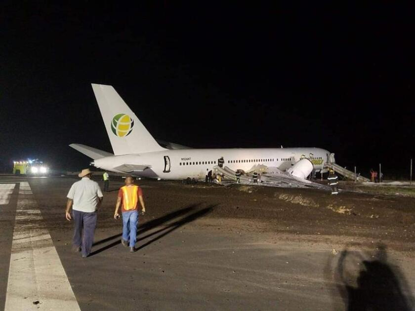 Fire fighters and workers at the site where a Fly Jamaica flight landed Nov. 9, 2018, at the Cheddi Jagan international airport in Georgetown (Guayana). EPA- EFE/STR/