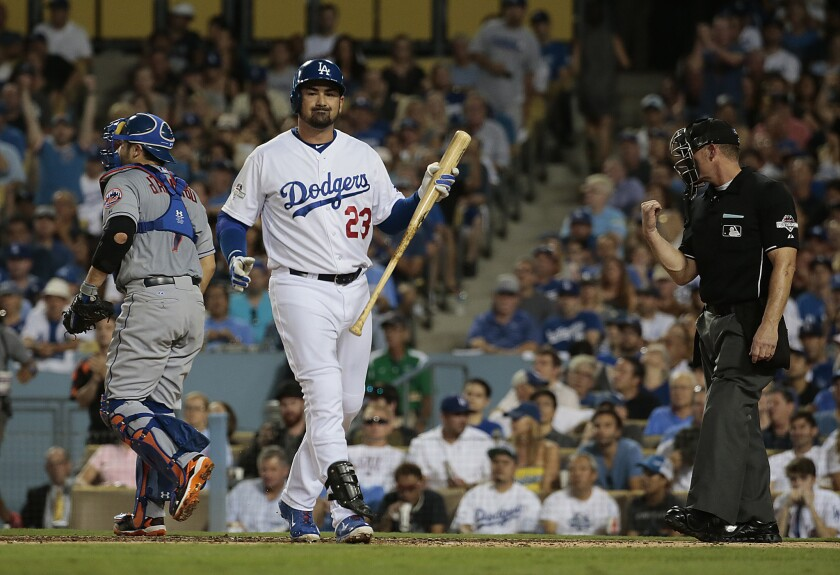 Dodgers first baseman Adrian Gonzalez reacts after striking out against Mets pitcher Noah Syndergaard during Game 2 of the NLDS.
