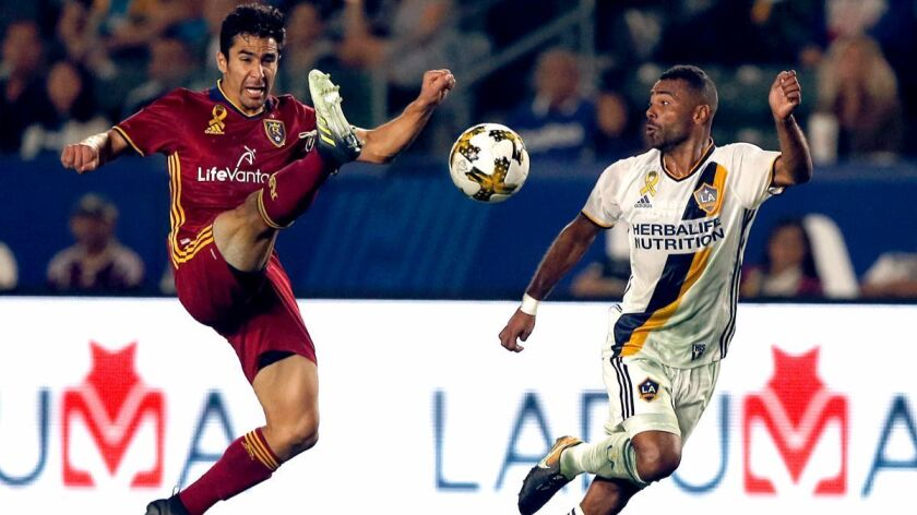 Ashley Cole, right, has played the left back position against opponents like Tony Beltran and Real Salt Lake with a great deal of skill and efficiency since joining the Galaxy in MLS.