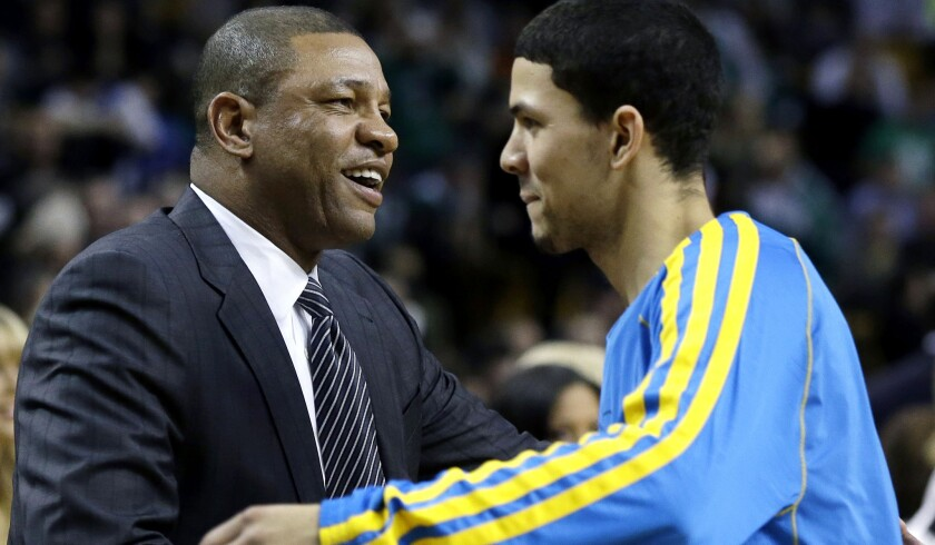 Doc Rivers, then the Boston Celtics' coach, greets his son, Austin, when he was a rookie with New Orleans.