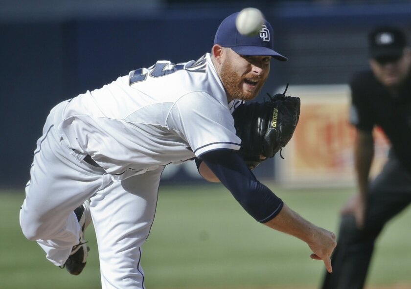 San Diego Padres starting pitcher Ian Kennedy works against the Milwaukee Brewers in the first inning of a baseball game Thursday, Oct. 1, 2015, in San Diego.  (AP Photo/Lenny Ignelzi)