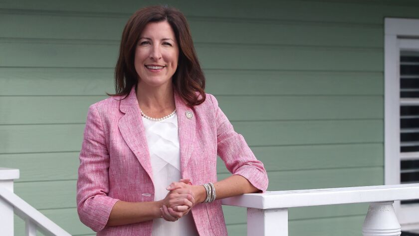 Cottie Petrie-Norris is a newly elected congress woman in California. She stands at her Laguna Beach