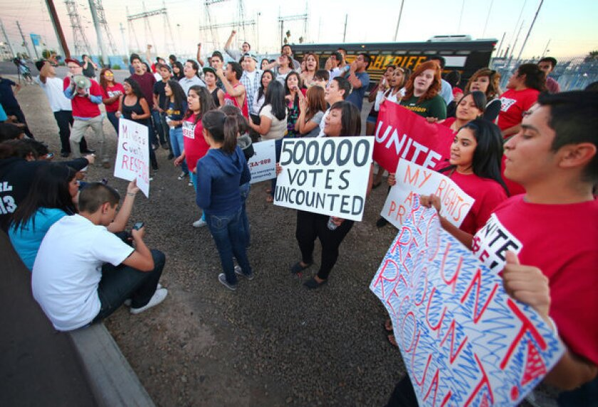 Members of Unite Here and Promise Arizona in Action protested outside the Maricopa Ballot Tabulation Center in Phoenix this month to decry the time spent counting ballots cast Nov. 6. The last ballots were finally counted this week.