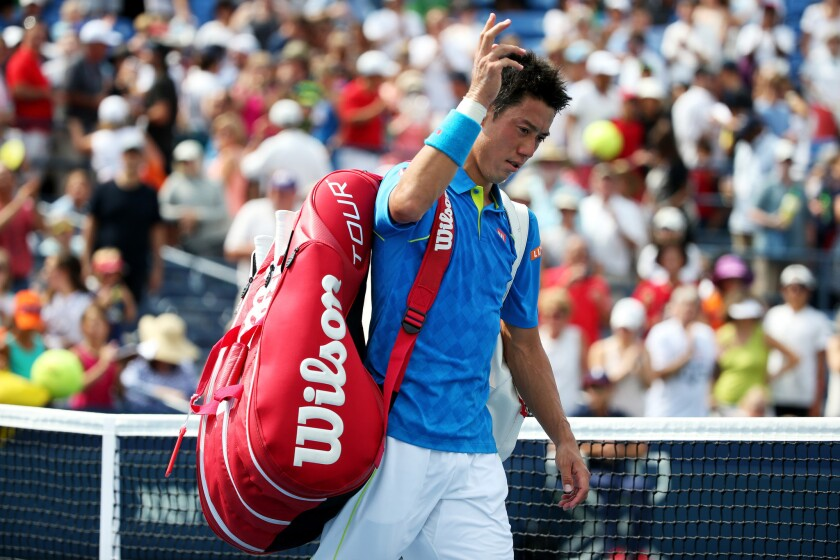 Kei Nishikori walks off of the court after losing against Benoit Paire during the first round of the 2015 U.S. Open.