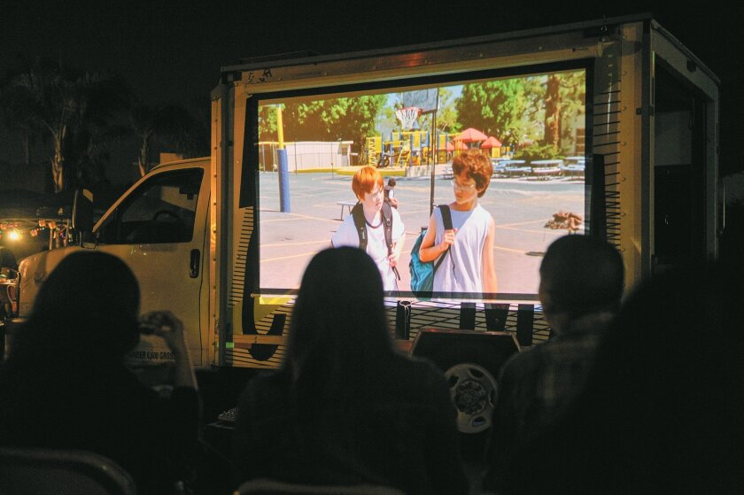 Drive-By Cinema, a community outreach project by San Diego's Pacific Arts Movement, stopped by a street festival at Hoover High School recently and showed films outdoors.