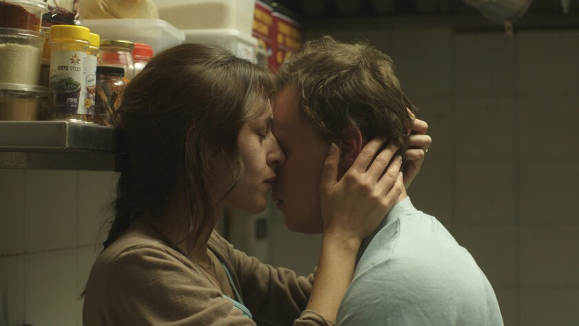 "Sarah Adler and Tim Kalkhof in the movie ""The Cakemaker."""