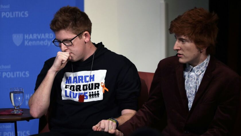 Marjory Stoneman Douglas High School students Matt Deitsch, left, and Ryan Deitsch participated in a panel discussion about guns on Tuesday at Harvard in Cambridge, Mass.