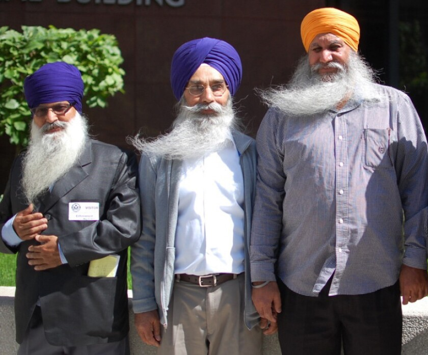 From left to right are Lakhbir Singh, Palwinder Singh and Jagtar Singh Anandpuri. They are three of the four truck drivers who complained about religious discrimination at the J.B. Hunt trucking company.