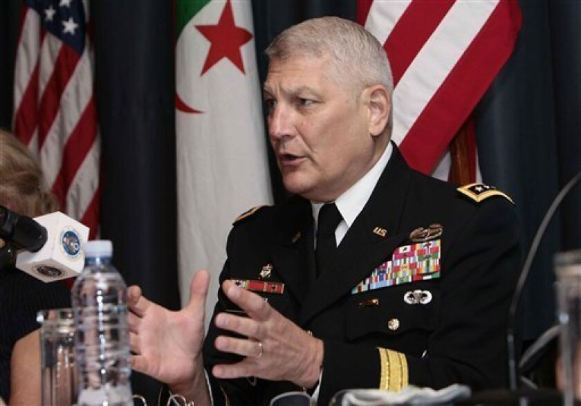 Gen. Carter Ham, the head of the U.S. African command, gestures during a conference on terrorism in the Sahara held in Algiers, Algeria, Thursday, Sept. 8, 2011. The two-day conference on terrorism in the Sahara was originally expected to focus just on al-Qaida, but has now become inextricably tied up with the civil war in neighboring Libya. (AP Photo)