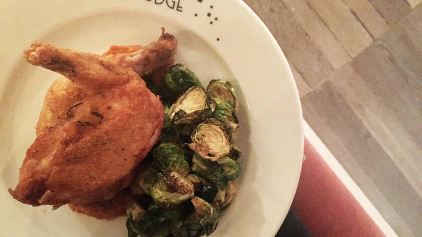 The roast chicken with sweet carrot mash and crispy Brussels sprouts at Au Fudge.