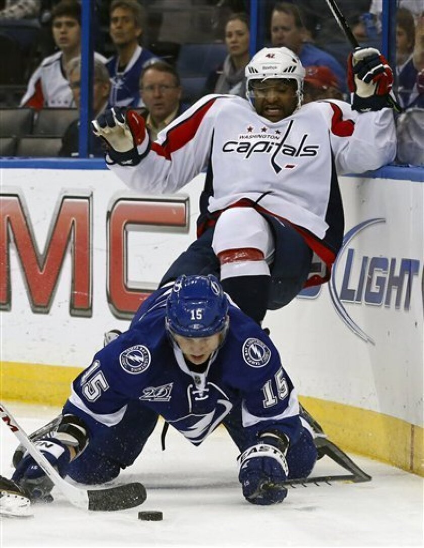 Tampa Bay Lightning's Brian Lee (15) collides with Washington Capitals' Joel Ward during the first period of an NHL hockey game on Thursday, Feb. 14, 2013, in Tampa, Fla. (AP Photo/Mike Carlson)