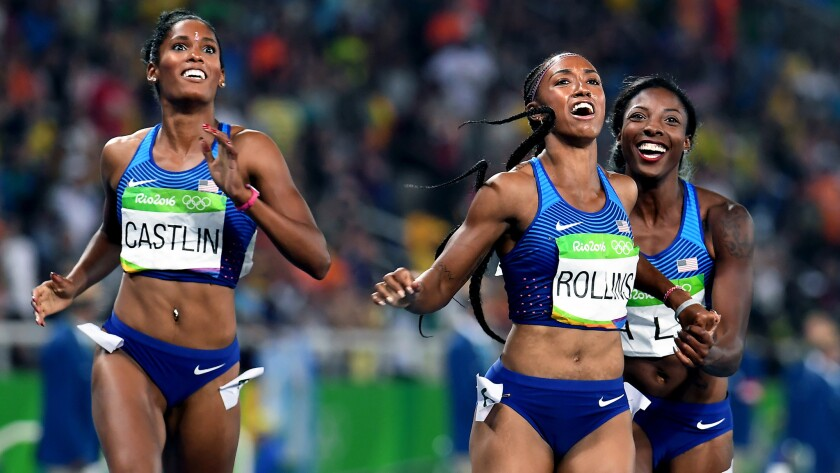 American hurdlers (from left) Kristi Castlin, Brianna Rollis and Nia Ali check the scoreboard to see that they swept the women's 100-meter hurdles.