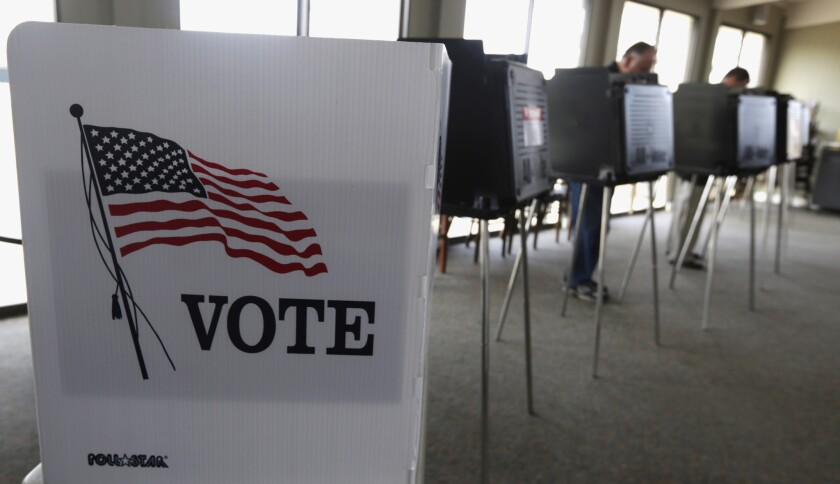 Primary voters cast their ballot in Hinsdale, Ill., in March.