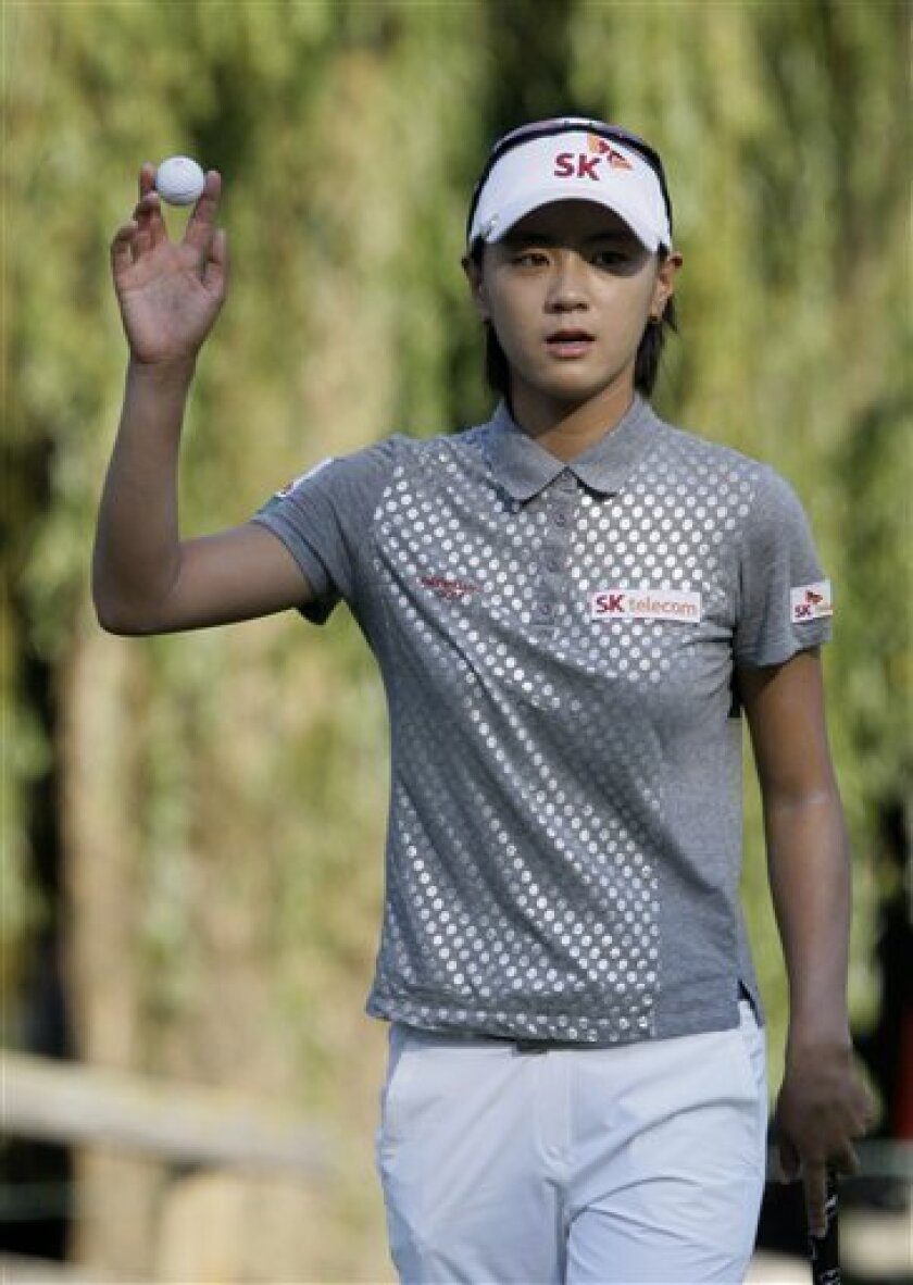 Na Yeon Choi, of South Korea, waves to the gallery after putting out on the ninth hole during the first round of the U.S. Women's Open in Bethlehem, Pa. on Thursday. (AP Photo/Gene J. Puskar)