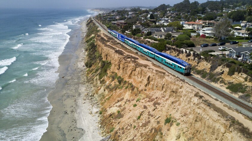 A Coaster train on the bluffs in Del Mar, where the transit district plans to install a fence.