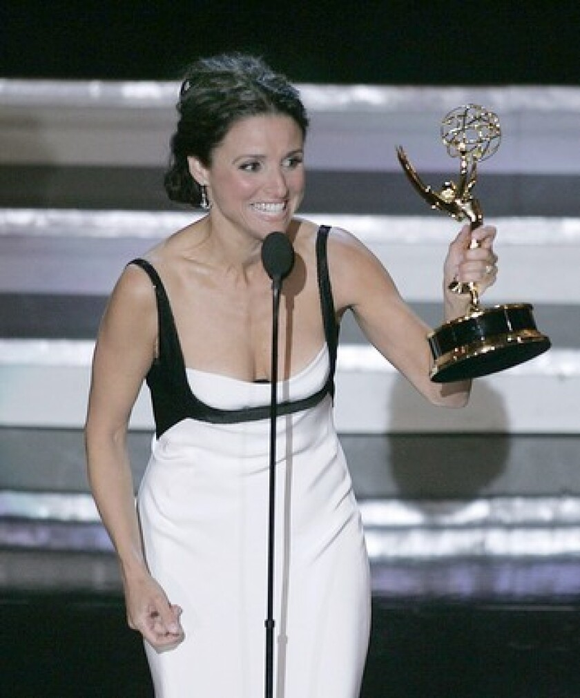 "Julia Louis-Dreyfus wins her second Emmy, breaking the so-called ""Seinfeld curse,"" in 2006."