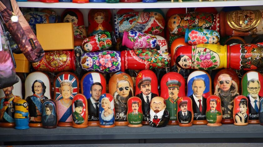 Russian matryoshka nesting dolls — including ones of both sunglass-clad and tie-wearing Putin — are