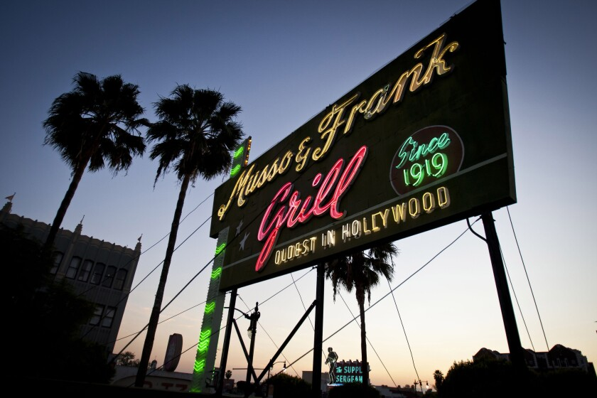Musso & Frank's sign lights up the Hollywood sky