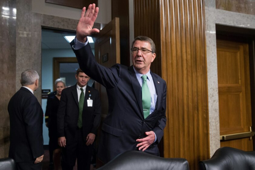 Defense Secretary Ash Carter waves as he arrives on Capitol Hill in Washington, Wednesday, July 29, 2015, to testify before the Senate Armed Services Committee hearing on the impacts of the Joint Comprehensive Plan of Action (JCPOA) on U.S. Interests and the Military Balance in the Middle East. (AP Photo/Andrew Harnik)