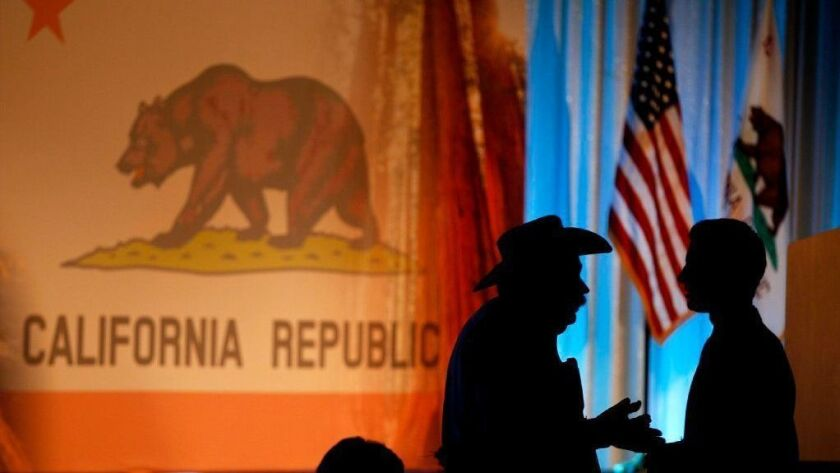California Republican Party members are silhouetted talking at the state GOP's 2015 fall convention in Anaheim
