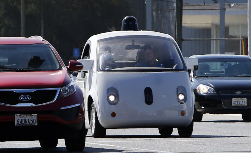 A Google self-driving car rolls through Mountain View, Calif., in October.