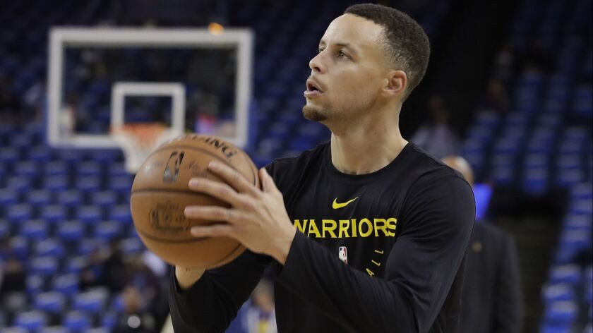Warriors guard Stephen Curry works out before a game Wednesday.