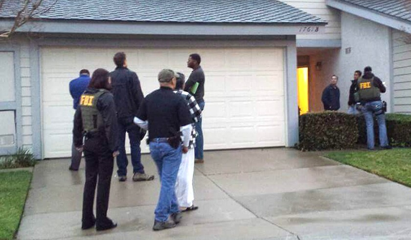 FBI agents executed a federal search warrant at the Corona home of the brother of San Bernardino terror attack gunman Syed Rizwan Farook on Thursday.
