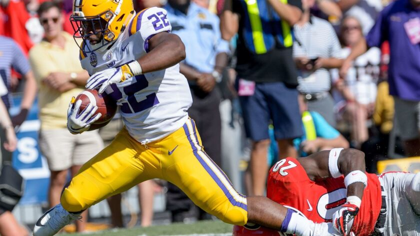 LSU running back Clyde Edwards-Helaire (22) runs against Georgia defensive back J.R. Reed (20) during a game in Baton Rouge, La., on Saturday.