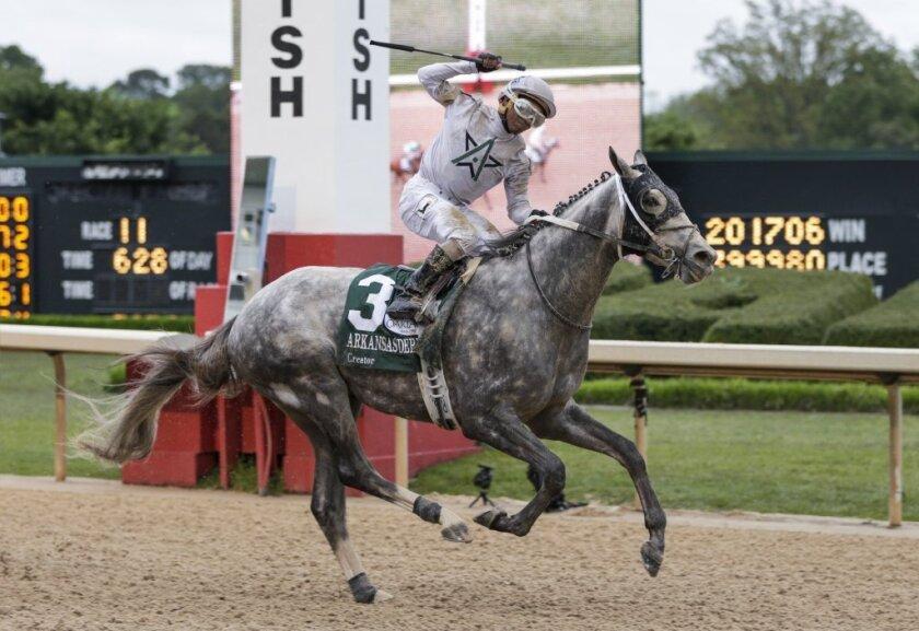 Jockey Ricardo Santana Jr. celebrates as Creator wins the Arkansas Derby on April 16.