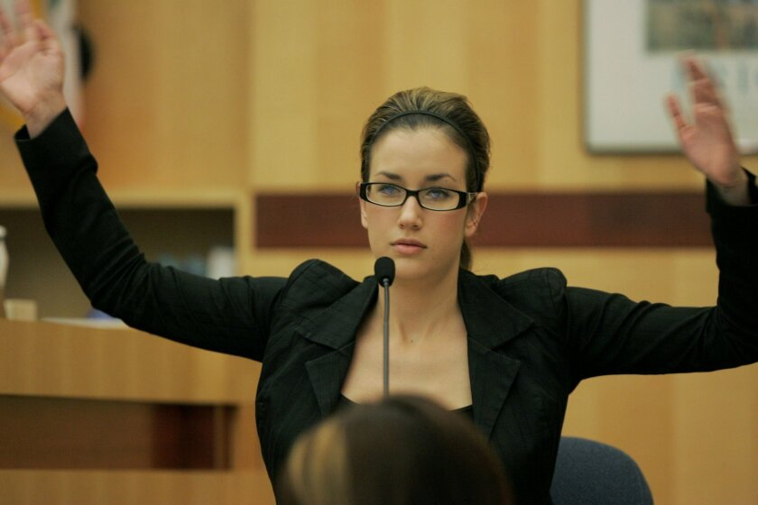 <p>  Jessica Migdal testified yesterday about how Rachel Silva flailed her arms during a road-rage incident in Oceanside in 2003.  <em>   &#8201; Charlie Neuman / Union-Tribune photos  </em> </p>