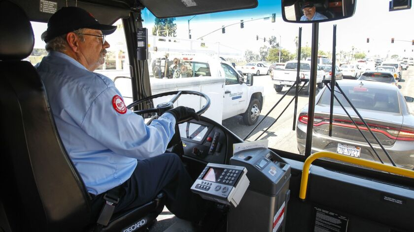 Bus driver Tom Middleton waits at a traffic light in San Diego. He used to have a career as a software engineer.