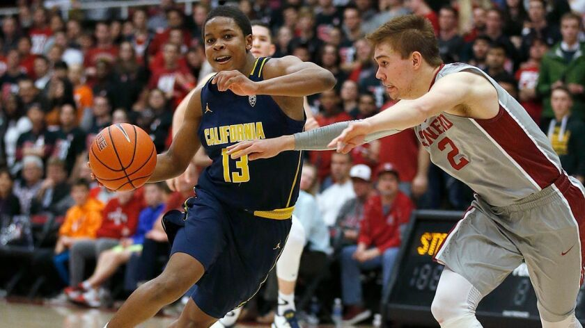 California guard Charlie Moore (13) drives against Stanford guard Robert Cartwright (2) during the second half Friday.