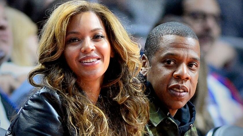 Beyonce and Jay-Z courtside at L.A.'s Staples Center as they watch the Brooklyn Nets play the Los An