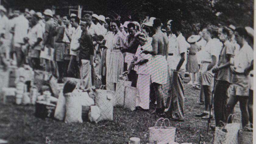 Internees at the Santo Tomas camp in Manila arrived with just the belongings they could carry from their outside residences.