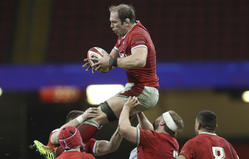 FILE - In this Saturday, Feb. 27, 2021 file photo, Wales' Alun Wyn Jones gathers the ball in a line out during the Six Nations rugby union match between Wales and England at the Millennium stadium in Cardiff, Wales. Wales great Alun Wyn Jones was selected on Thursday May 6, 2021, as captain of the British and Irish Lions for the first time for the tour of South Africa. (David Davies/Pool via AP, File)