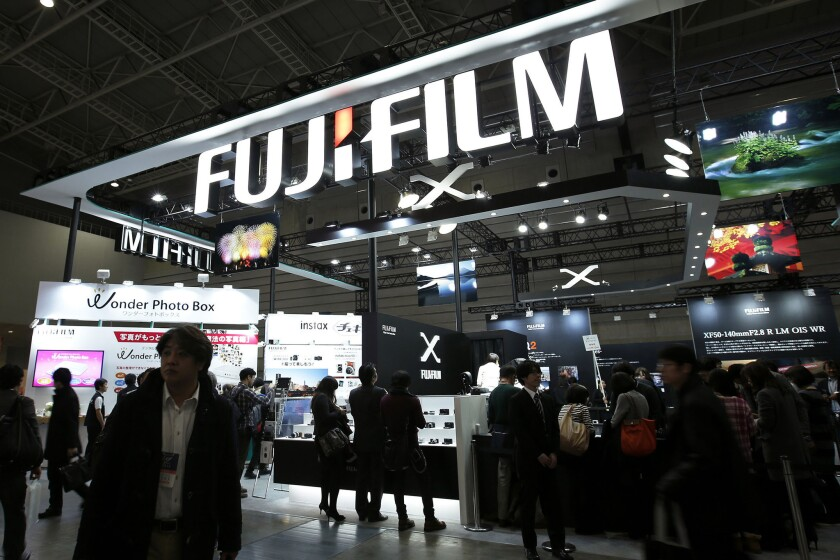 Japan's Fuijifilm is taking over Xerox in a restructuring intended to slash costs.