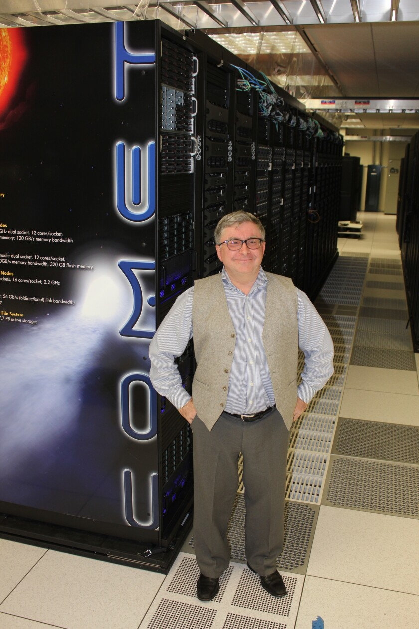 Michael Norman, director of the San Diego Super Computer Center at UCSD, stands in front of Comet, the center's latest and fastest super computer.