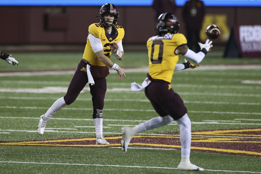 Minnesota quarterback Tanner Morgan (2) passes the ball to wide receiver Rashod Bateman (0) during the first half of the team's NCAA college football game against Purdue, Friday, Nov. 20, 2020, in Minneapolis. Minnesota won 34-31. (AP Photo/Stacy Bengs)