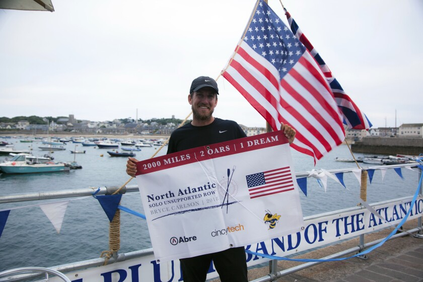 Bryce Carlson poses for a photo in England after completing his solo unsupported row across the Atlantic, Aug. 4, 2018.