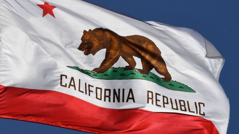 The California state flag flies outside Los Angeles City Hall.