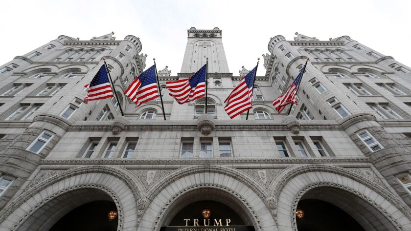 The Trump International Hotel is near Cork Wine Bar, whose owners say President Trump is unfairly using the power of his post to lure business.