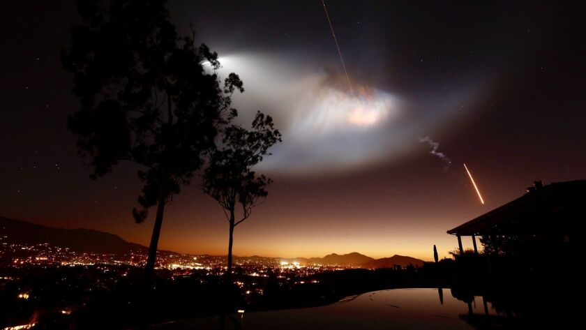 A SpaceX Falcon 9 rocket launch from Vandenberg Air Force Base lights up the Southern California sky in October.