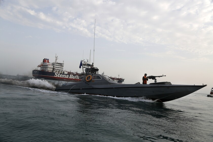 In this July 21, 2019, photo, a speedboat of the Iran's Revolutionary Guard moves around British-flagged oil tanker Stena Impero, which was seized by the Guard on July 19 in the Iranian port of Bandar Abbas.