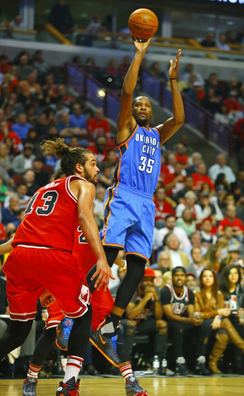 Oklahoma City Thunder forward Kevin Durant (35) shoots over Chicago Bulls center Joakim Noah (13) during the second half of an NBA basketball game in Chicago, on Thursday, Nov. 5, 2015. The Bulls won the game 104-98. (AP Photo/Jeff Haynes)