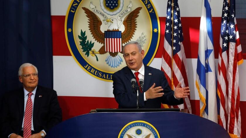 U.S. Ambassador to Israel David Friedman listens as Israeli Prime Minister Benjamin Netanyahu delivers a speech during the opening of the U.S. Embassy in Jerusalem.