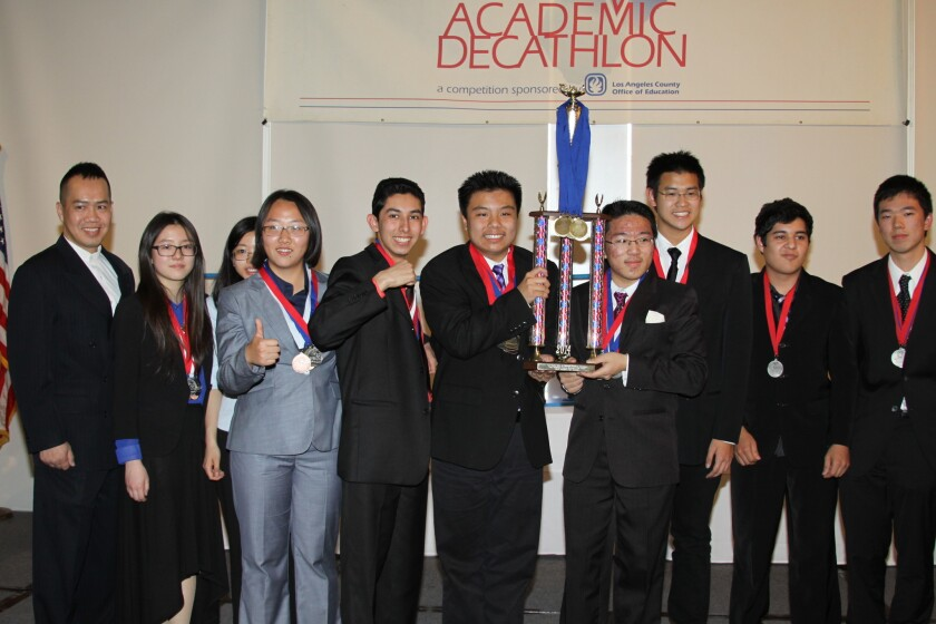 Students on Mark Keppel High School's decathlon team pose with their trophy at the Quiet Cannon Country Club after being named winners of the 2014 Los Angeles County Academic Decathlon.