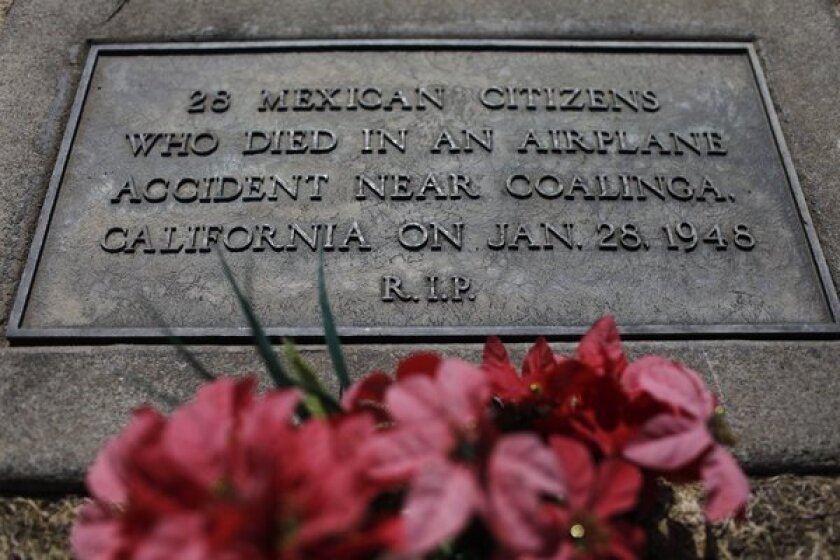 Before Monday's Mass, the grave marker for the Mexican nationals killed in a 1948 plane crash did not include their names.