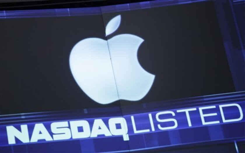 FILE - In this Tuesday, Aug. 21, 2012, file photo, the Apple logo is shown on a stock ticker at the Nasdaq MarketSite, in New York. Apple is entering the home stretch of what will likely be its best holiday season yet as shoppers snap up iPhones and iPads in record numbers in December 2012. Yet the world's most valuable company has lost its luster among investors, causing Apple's stock price to plunge by more than 20 percent from a peak reached less than three months ago when the latest iPhone went on sale. (AP Photo/Mark Lennihan)