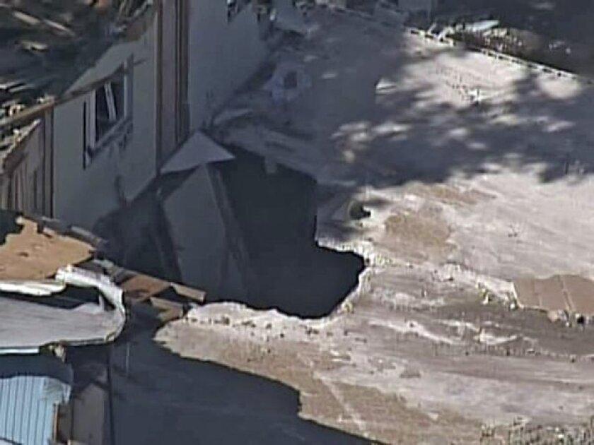 Florida sinkhole visible after victim's home demolished